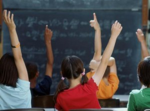 school-kids-classroom-raising-hands